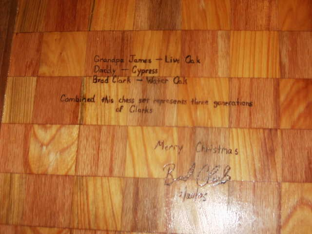 back of the chess board with woodburned message