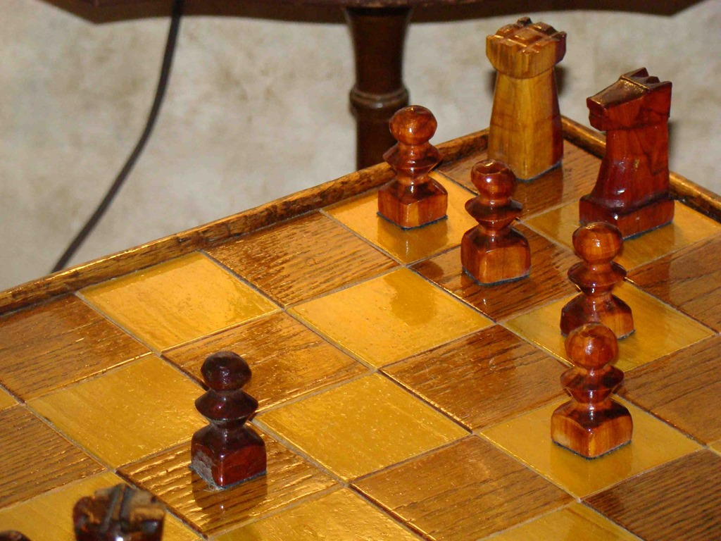 close up view of chess set and hand carved pieces