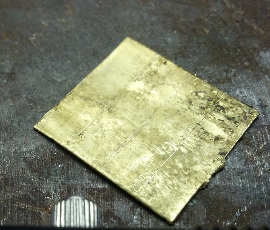 squared up brass sheet marked for cutting