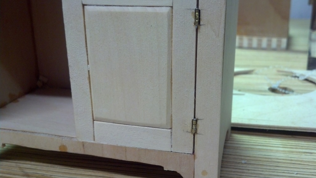 hinges installed on scale cabinet door