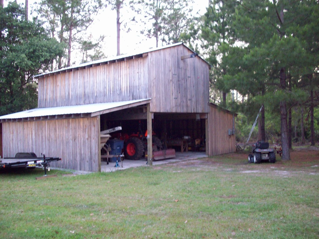 Three stall barn with second level loft built with sawmill lumber