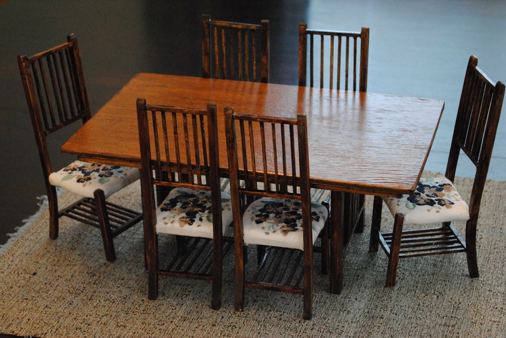 Completed scale dining room table and 6 chairs with custom embroidered seat cushions