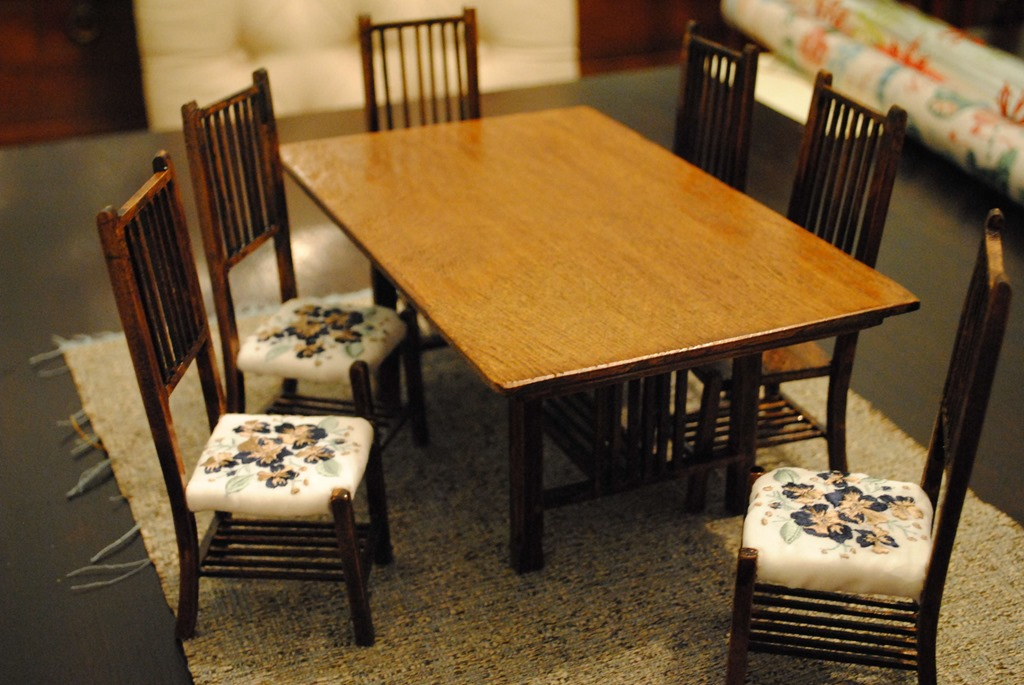 model table and chairs with embroidered seat cushions